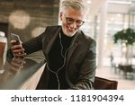 smiling mature male in business ... | Shutterstock . vector #1181904394