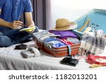 man   packing the luggage... | Shutterstock . vector #1182013201