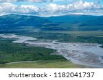 Aerial view of Katmai National Park. Braided river with sandbars, lush green mountains in backgrounds