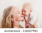 happy young mother with her... | Shutterstock . vector #118207981