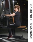 woman at the sport gym doing... | Shutterstock . vector #1182101911