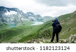 a trekker take photo at past... | Shutterstock . vector #1182123124