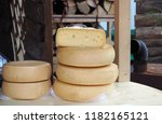 wheels of organic cheese made... | Shutterstock . vector #1182165121