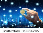 bitcoin in hand of business man ... | Shutterstock . vector #1182169927