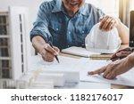 hands of architect or engineer... | Shutterstock . vector #1182176017