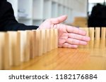 business hand stops domino... | Shutterstock . vector #1182176884