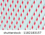 red striped cocktail straws on... | Shutterstock . vector #1182183157
