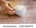 hot coffee with sunlight ...   Shutterstock . vector #1182186994