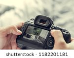 photographer with camera in hand | Shutterstock . vector #1182201181