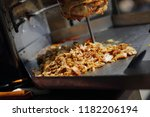 meat roasted on a vertical spit ... | Shutterstock . vector #1182206194