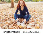 laughing carefree young woman... | Shutterstock . vector #1182222361
