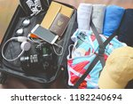 luggage  with clothing and... | Shutterstock . vector #1182240694