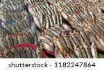 variety of fishes in wet market ... | Shutterstock . vector #1182247864