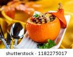 pumpkin stuffed with stew meat... | Shutterstock . vector #1182275017