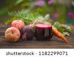 beet  juice in glass on wooden... | Shutterstock . vector #1182299071