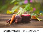 beet carrot juice in glass on... | Shutterstock . vector #1182299074