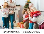 grandparents embracing with... | Shutterstock . vector #1182299437