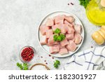 raw meat cubes in a bowl with... | Shutterstock . vector #1182301927