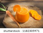 Carrot Juice In Glass On Wooden ...