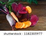 beet carrot juice in glass on... | Shutterstock . vector #1182305977