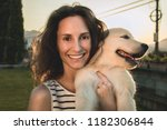 happy woman with her adorable... | Shutterstock . vector #1182306844
