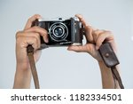 close up of female photographer ... | Shutterstock . vector #1182334501