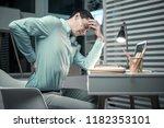 my back. tired business man... | Shutterstock . vector #1182353101