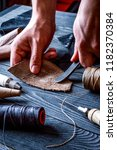 work in leather shop on dark... | Shutterstock . vector #1182370384