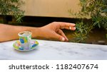 cigarette and a cup of turkish... | Shutterstock . vector #1182407674