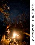man near the burning bonfire in ...   Shutterstock . vector #1182428704