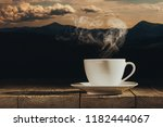 hot coffee on the table on a... | Shutterstock . vector #1182444067