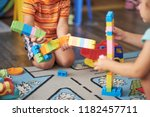 little asian child playing with ... | Shutterstock . vector #1182457711