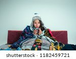 the young sick woman with flue... | Shutterstock . vector #1182459721