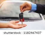the car salesman and the key to ...   Shutterstock . vector #1182467437