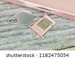 insert sim card on a smartphone ... | Shutterstock . vector #1182475054