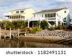 luxury beach houses on the... | Shutterstock . vector #1182491131