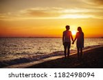 young happy couple on seashore... | Shutterstock . vector #1182498094