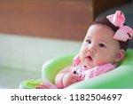innocent little baby is sitting ... | Shutterstock . vector #1182504697