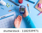 the diabetic measures the level ... | Shutterstock . vector #1182539971