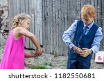 boy and girl spend fun on... | Shutterstock . vector #1182550681