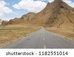 fall woods road  | Shutterstock . vector #1182551014