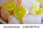 stewed dolly fish with lemon | Shutterstock . vector #1182587914