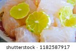 stewed dolly fish with lemon | Shutterstock . vector #1182587917