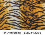 tiger patterned background | Shutterstock . vector #1182592291