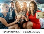 party people in a limo with... | Shutterstock . vector #1182630127