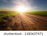 yellow field blue sky and sun. | Shutterstock . vector #1182637471