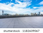 empty square with city skyline... | Shutterstock . vector #1182639067