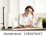 tired woman behind laptop       ... | Shutterstock . vector #1182676417