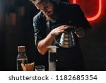 barista pouring boiling water... | Shutterstock . vector #1182685354