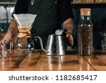 close up of hand holding kettle ... | Shutterstock . vector #1182685417